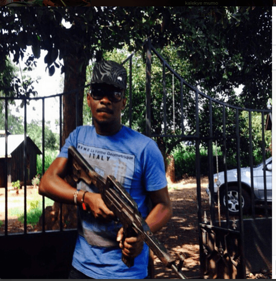 cop n - Gun play! Nameless shows off a gun looking mean and dangerous (PHOTO)